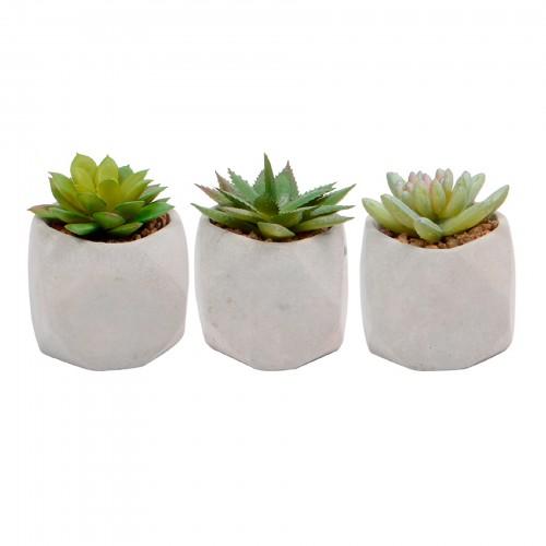 Vaso de concreto com planta artificial